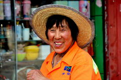 Pixian Old Town, China: Woman Wearing Straw Hat Royalty Free Stock Images