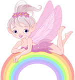 Pixie fairy on rainbow Royalty Free Stock Photo