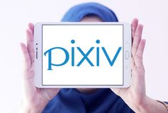 Pixiv online community logo. Logo of Pixiv online community on samsung tablet holded by arab muslim woman. Pixiv is a Japanese online community for artists Stock Image