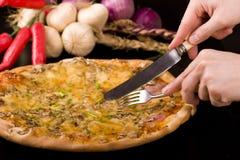 吃piza 免版税库存照片