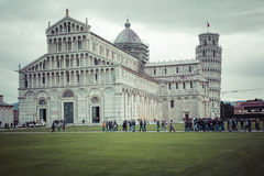 PIZA, ITALY - 10 MARCH, 2016: View of Leaning tower and the Basilica Royalty Free Stock Photo