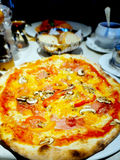 Piza on the table. Pizza on the table Italian food restaurant stock image