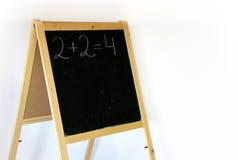 Pizarra 2+2=4 Fotografía de archivo libre de regalías