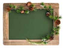 Pizarra con la decoración del marco de madera y de la Navidad Fotografía de archivo libre de regalías