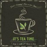 Pizarra de Brown con una taza de té y de texto calientes Imagen de archivo