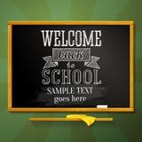 Pizarra de la escuela con el saludo para la recepción detrás Foto de archivo