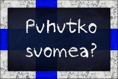 Pizarra del suomea de Puhutko con el marco de la bandera de Finlandia Fotos de archivo