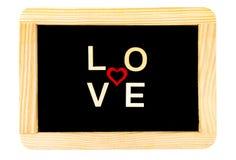 Pizarra del vintage del marco de madera aislada en blanco con la palabra AMOR creado de las letras de madera fotografía de archivo libre de regalías