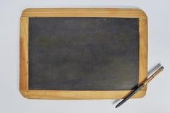 Pizarra y lápiz de pizarra antiguos Fotografía de archivo