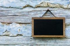 Pizarra y paredes de madera Imagen de archivo libre de regalías