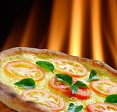 Pizza. Baked in the oven with a wood fire to the bottom Royalty Free Stock Images