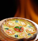 Pizza. Baked in the oven with a wood fire to the bottom Royalty Free Stock Photos