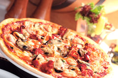 Pizza. Italian pizza with seafood topping royalty free stock images