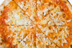 Pizza. Background from pizza with hen and pineapple Royalty Free Stock Photos