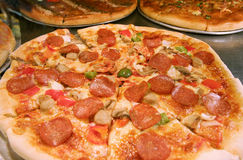 Pizza. Tasty pizza with sausage and mushrooms stock image