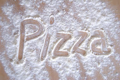 Pizza. Written with white flour Royalty Free Stock Photography