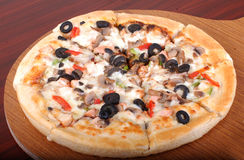 Pizza. Fresh and tasty pizza with loads of yummy toppings Stock Images