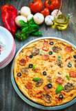Pizza. Delicious pizza on old wood table with several ingredients Stock Photos