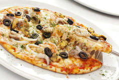 Pizza. Appetizing pizza on a white plate Stock Images