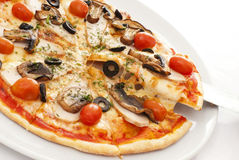 Pizza. Appetizing pizza on a white plate Royalty Free Stock Photo