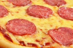 Pizza. Pepperoni pizza fragment closeup photo Royalty Free Stock Photography