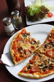 Pizza. A piece of pizza, delicious meal royalty free stock images