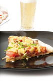 Pizza. Appetizing pizza with chicken, tomatoes and sausage Royalty Free Stock Photography