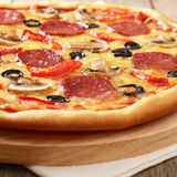 Pizza. Pepperoni pizza with mushrooms and peppers Stock Photo