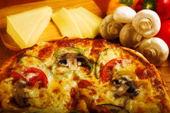 Pizza. With red tomato, mushrooms and cheese Royalty Free Stock Photos
