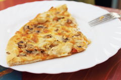 Pizza. A piece of pizza with cheese and mushrooms Stock Photography