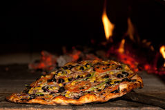 Pizza in the wood oven! royalty free stock photography