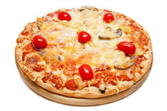 Pizza. Delicious italian pizza with ham, pineapple, cheese and tomatoes isolated on white background Royalty Free Stock Photos