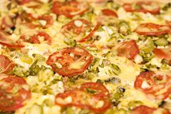 Pizza. The background from large colorful pizza macro Stock Photography