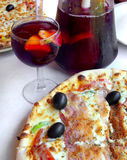 Pizza. And sangria served in an italian restaurant Royalty Free Stock Photography