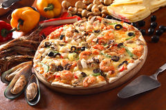 Pizza. Italian pizza with seafood toping royalty free stock image