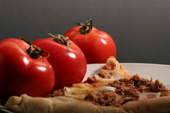 Pizza. With tomatoes on a black background Stock Photography