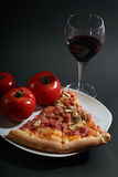 Pizza. With tomatoes on a black background Royalty Free Stock Image