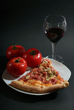 Pizza. With tomatoes on a black background Royalty Free Stock Photos