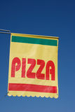 Pizza. Sign, banner against blue sky Royalty Free Stock Photography