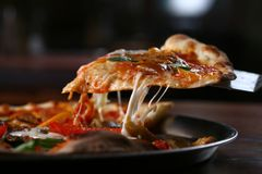Pizza. Tasty pizza lslice with cheese strings stock images