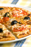 Pizza. Romana with olives tomato and melted mozzarela Royalty Free Stock Image