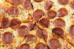 Pizza. Closeup of a sliced pepperoni pizza Royalty Free Stock Photos