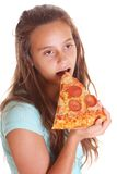 Pizza adolescente de la consumición Imágenes de archivo libres de regalías