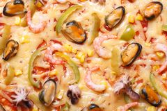 Pizza ai frutti di mare with octopus, mussels and shrimp texture Royalty Free Stock Images
