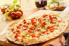 Pizza alsaziana francese tradizionale arrostita della fiamma immagini stock