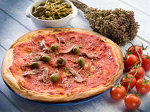 Pizza with anchovies Stock Photos