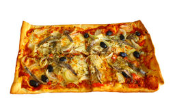 Pizza with anchovies, bulbs and chili. A large rectangular pizza for families, in four divides cut. this is occupied with bulbs, olives, anchovies, chilies stock photos