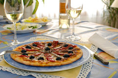 Pizza with Anchovies. And olives on a blue dish Stock Photos