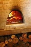 Pizza in antique owen Stock Image