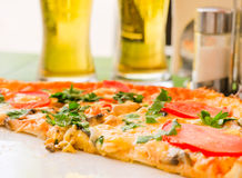 Pizza. Appetizing pizza with tomatoes, herbs and cheese stock photo